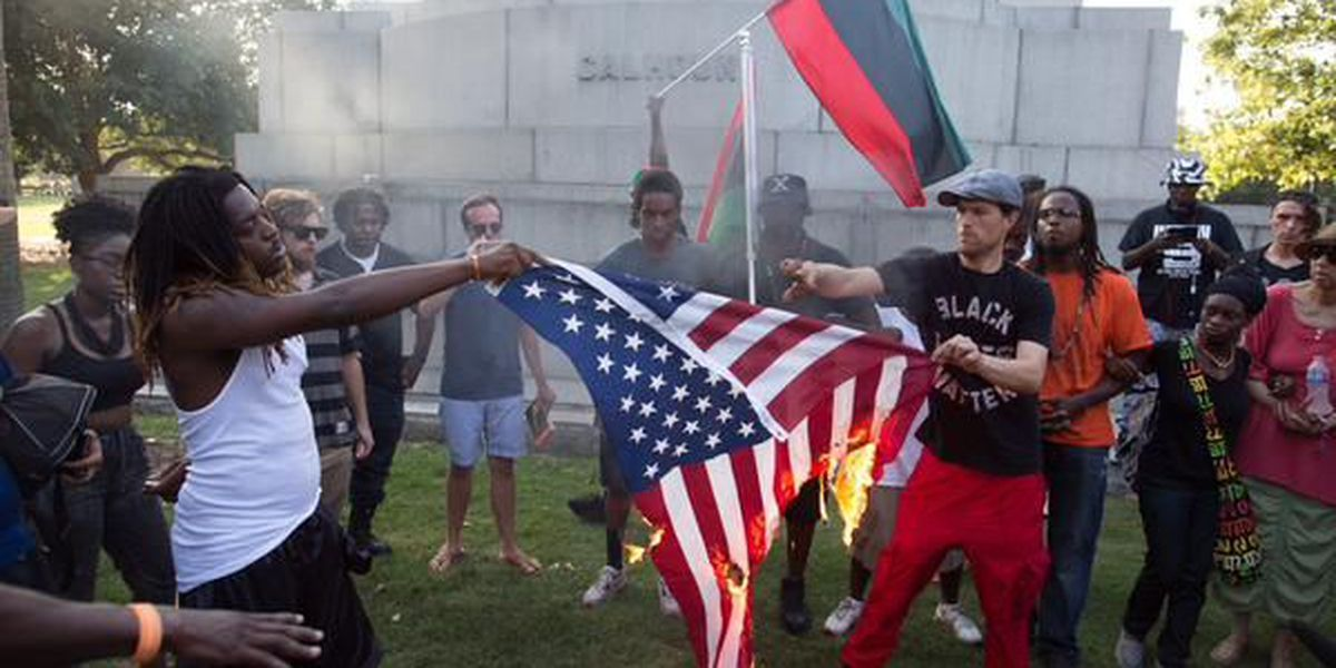 Photos show group burning American, Confederate flags in downtown Charleston