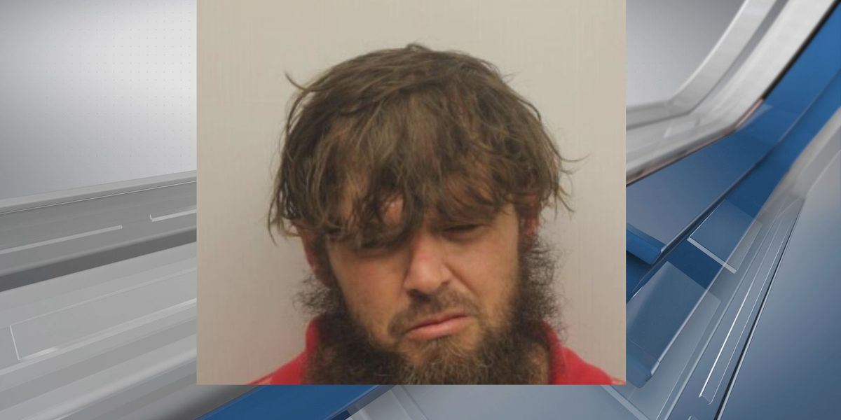 Suspect accused of setting woman on fire during domestic dispute