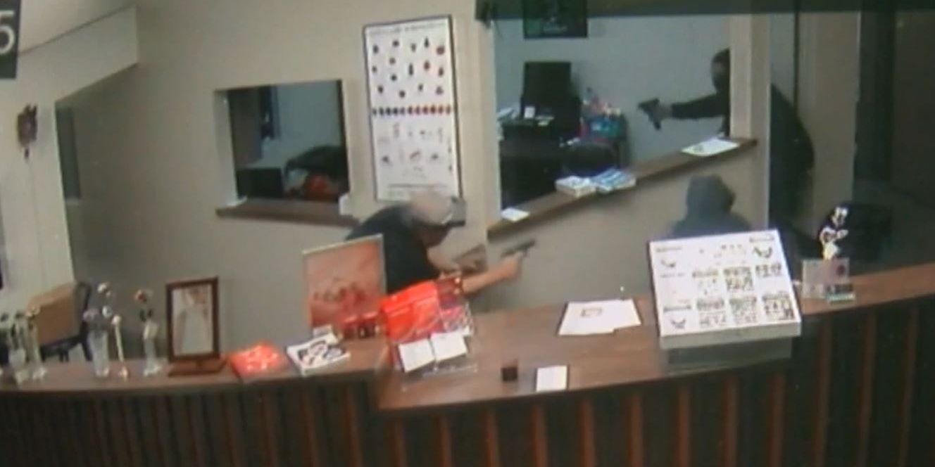 Caught on camera: Armed jeweler confronts masked robbery suspects in shootout