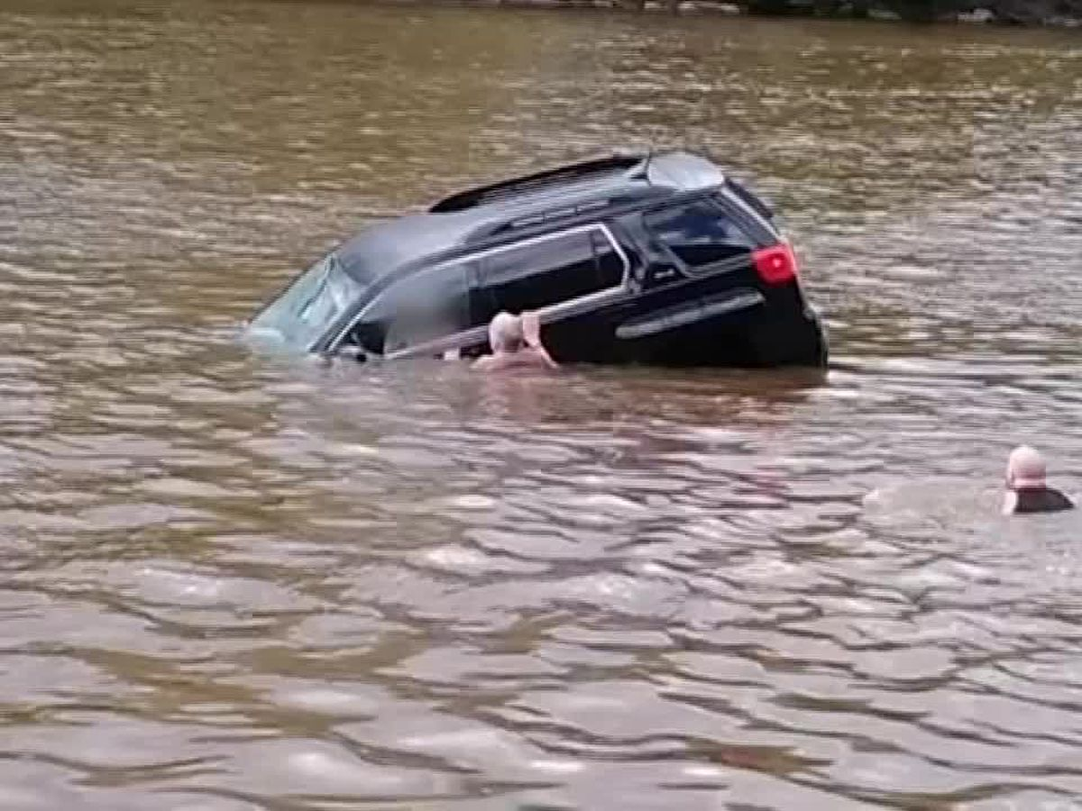 Video: Woman saved from submerging vehicle just before it sinks