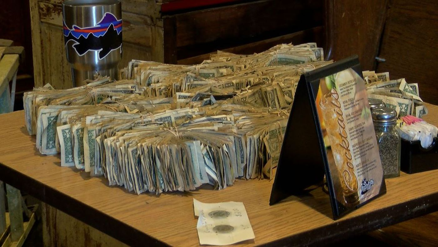 Volunteers removed more than $6,000 in cash from the restaurant's ceiling Wednesday. The money is being donated to two pet rescue groups. (Source: Live 5)